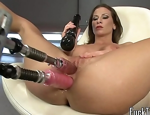 Busty MILF drilled with two sex-toy machine