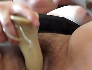A fat girl jumps on a unstinted rubber dick and masurbiruet them his hairy pussy
