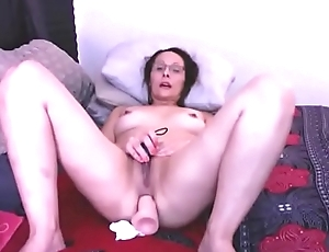 Mature star with glasses fucks her asshole